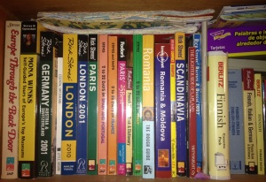 Just one of our many shelves of travel guidebooks!
