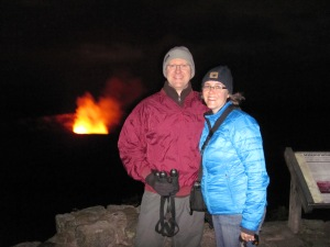 Lava lake reflected in vapors and gases at night behind us.