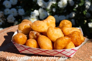 Delicious loukoumades smothered in honey and topped with cinnamon