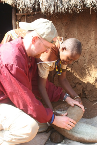 Teaching Jeff to mill corn, Barbaig village, Tanzania