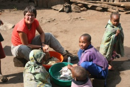Helping out with the laundry in Bacho, Tanzania